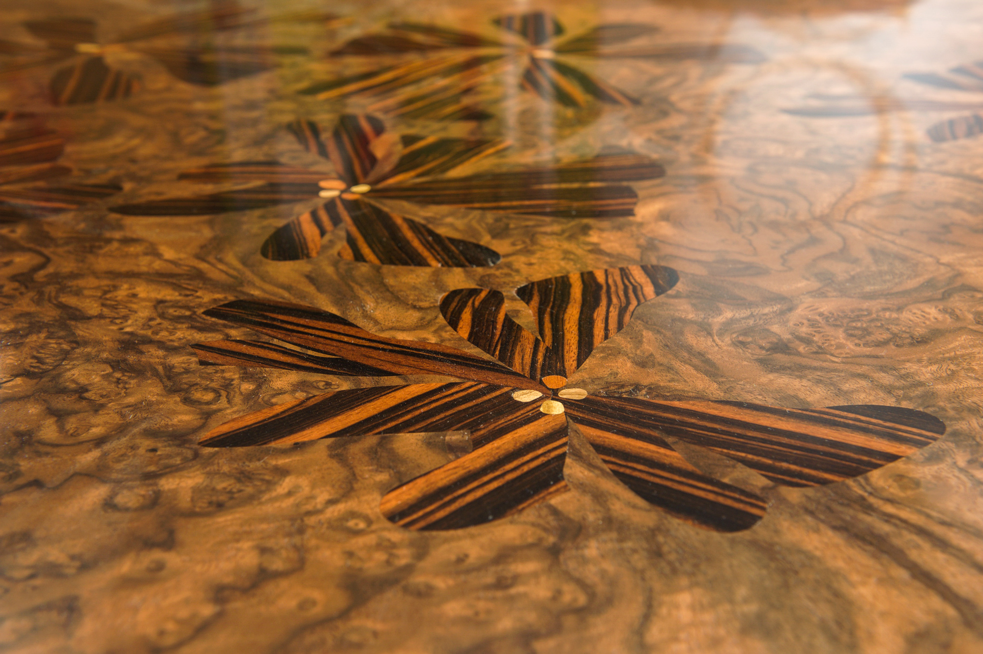 inlayed flowers in wood in a table surface, french polished.