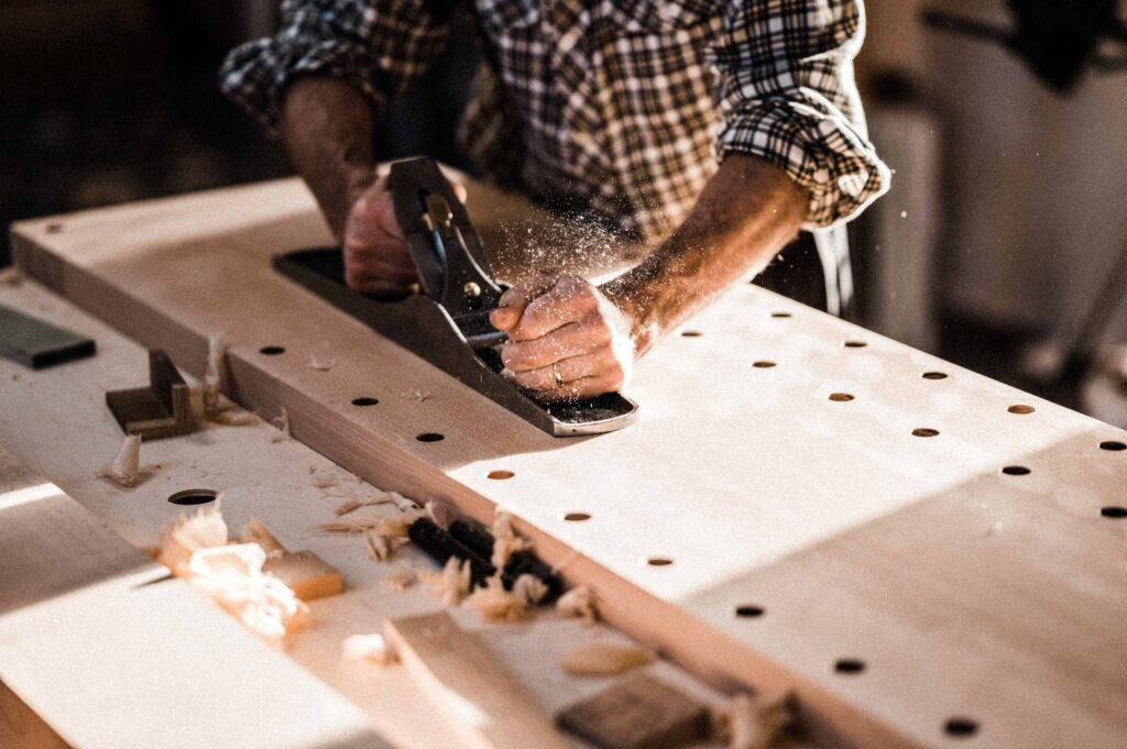 a student at Rowden, flattening their bespoke workbench on a woodworking course